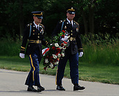 Two members of the United States military carry a wreath for U.S. President Barrack Obama to place at Abraham Lincoln National Cemetery in Elwood, Illinois on Memorial Day, Monday, May 31, 2010.     .Credit: David Banks / Pool via CNP
