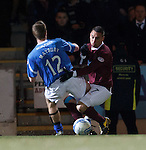 Alan Maybury tackles Suso Santana in the box and the ref awards a last gasp penalty to Hearts in normal time
