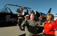 Oct 08, 2004 - Byron, CA, USA - Contra Costa Times reporter Rowena Coetsee tells Vinnie Warren what it was like to pull 5 G's during her flight in an L-39 jet at Byron Airport in Byron, Calif., Friday Oct. 8, 2004. Pilot John Posson is at left. This jet and others from the Byron based aerobatic team will perform during the Fleet Week air show over the San Francisco Waterfront this weekend..(Credit Image: © Alan Greth)