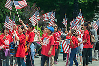 Students from P.S. 2 in Chinatown march in the annual Flag Day Parade on Friday, June 14, 2013, starting at New York City Hall Park. Flag Day, was created by proclamation by President Woodrow Wilson on June 14, 1916 as a holiday honoring America's flag but it was not until 1949 when it became National Flag Day.  The holiday honors the 1777 Flag Resolution where the stars and stripes were officially adopted as the flag of the United States. (© Richard B. Levine)