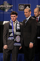 The Colorado Rapids first pick, and sixth overall Nico Colaluca poses for photographers with MLS Commissioner Don Garber during the first round of the MLS SuperDraft at the Indiana Convention Center, Indianapolis, IA, on Jan 12, 2007.