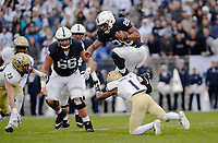 STATE COLLEGE, PA - SEPTEMBER 02:  Penn State Rb sequin Barkley (26) hurdles an Akron defender. The Penn State Nittany Lions defeated the Akron Zips 52-0 on September 2, 2017 at Beaver Stadium in State College, PA. (Photo by Randy Litzinger/Icon Sportswire)