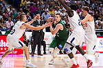 Real Madrid's player /rm20, Othello Hunter and Luka Doncic and Unicaja Malaga's player Adam Waczynski during match of Liga Endesa at Barclaycard Center in Madrid. September 30, Spain. 2016. (ALTERPHOTOS/BorjaB.Hojas)