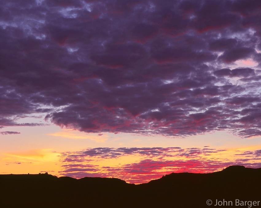 67NDTR_101 - USA, North Dakota, Theodore Roosevelt National Park, North Unit, Sunset clouds over grassland and rolling hills.