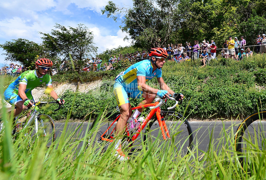 Jul 28, 2012; Dorking, United Kingdom; Alexandr Vinokurov (KAZ) races in traffic at Box Hill during the mens cycling race. Mandatory Credit: Mark J. Rebilas-USA TODAY Sports