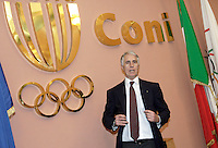 Il nuovo presidente del Coni Giovanni Malago' posa davanti al simbolo dopo la sua elezione, al Consiglio Nazionale Elettivo a Roma, 19 febbraio 2013. Malago' e' diventato nuovo presidente con 40 voti a 35..Italian Olympic Committee (CONI) newly elected president Giovanni Malago' poses near the logo after winning the challenge at the Elective Council in Rome, 19 February 2013..UPDATE IMAGES PRESS/Riccardo De Luca