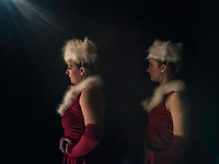 Dancers wait in the wings for their cue during rehearsals for a dance company's Christmas performance.