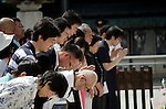 August 15, 2011 - Tokyo, Japan - People coming to commemorate victims of WWII  : Thousands of people visit this shrine to pay their respect to the Japanese war soldiers who died fighting in World War II which marks the 66th anniversary of the end of WWII.  (Photo by Yumeto Yamazaki)