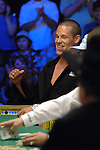 Patrik Antonius, on the short stack, wins the first pot.