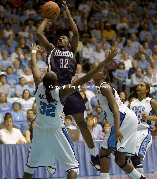 CHAPEL HILL, NC--15 January 2007--101507JS09-UConn's Kalana Greene puts in two of her team-high 23 points over North Carolina's Rashanda McCants during their game Monday at the Carmichael Auditorium on the campus of the University of North Carolina in Chapel Hill, North Carolina.<br /> Jim Shannon / Republican-American