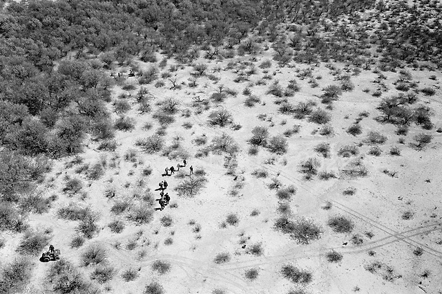 Tohno O'odham Indian Reservation, Arizona<br /> May 5, 2008<br /> <br /> A National Guard helicopter pilot Billy Dart, helps the US Border patrol in the Tohno O'odham Indian Reservation along the US Mexican border, track and capture a group of illegal Mexican immigrants. Although new roads, fence and vehicle barrier have been put in place along the US/Mexcian border in Arizona illegal traffic is still very heavy in the Tucson sector.