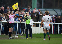 The ball girl throws the ball to Lawrence Rhys of Ealing Trailfinders during the Greene King IPA Championship match between London Scottish Football Club and Ealing Trailfinders at Richmond Athletic Ground, Richmond, United Kingdom on 26 December 2015. Photo by Alan  Stanford / PRiME Media Images