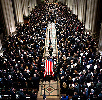 The Honor Guard carries the casket of former president George Herbert Walker Bush down the center isle following a memorial ceremony at the National Cathedral in Washington, Wednesday,  Dec.. 5, 2018.  <br /> <br /> CAP/MPI/RS<br /> &copy;RS/MPI/Capital Pictures