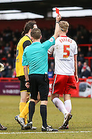 Fraser Franks of Stevenage (right) is sent off by Referee, Mr David Webb, (centre) during the Sky Bet League 2 match between Stevenage and Northampton Town at the Lamex Stadium, Stevenage, England on 19 March 2016. Photo by David Horn / PRiME Media Images.