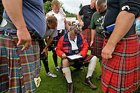 Competitors in the World Championships for tossing the caber get their results at the Inveraray Highland Games, held at Inveraray Castle in Argyll.