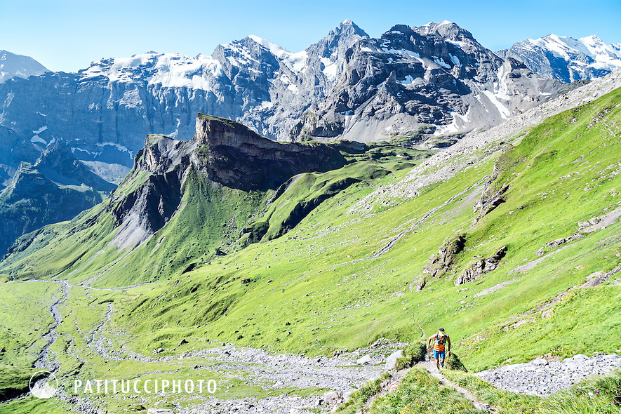 Trail running in a wide open green landscape above Lauterbrunnen, Switzerland on the way to the Schilthorn
