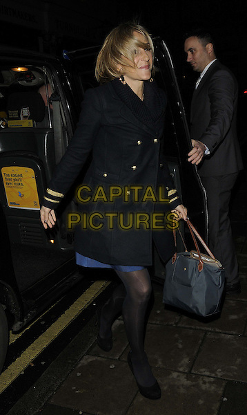 Emily Maitlis.attended the 'Ultimate News Quiz' in aid of Action for Children, Quaglino's bar & restaurant, Bury St., London, England, UK, 7th March 2013..full length black coat bag blue dress tights getting out of car taxi cab hair over face windy funny .CAP/CAN.©Can Nguyen/Capital Pictures.