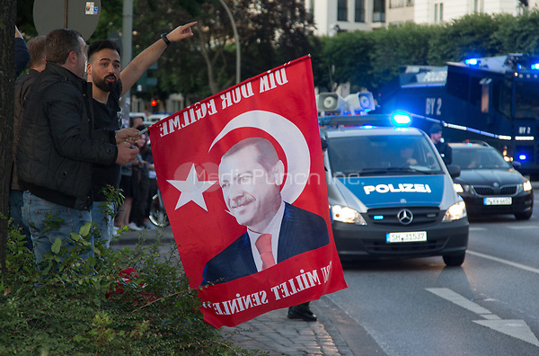 A man holds a flag with an image of the Turkish president Recep Tayyip Erdogan outside the Atlantic Hotel where Erdogan met the German chancellor Angela Merkel for bilateral talks held in conjunction with the G20 summit in Hamburg, Germany, 6 July 2017. Photo: Friso Gentsch/dpa /MediaPunch ***FOR USA ONLY***