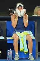 January 27, 2018: Number two seed Caroline Wozniacki of Denmark cools down with an ice towel in the Women's Final against number one seed Simona Halep of Romania on day thirteen of the 2018 Australian Open Grand Slam tennis tournament in Melbourne, Australia. Photo Sydney Low
