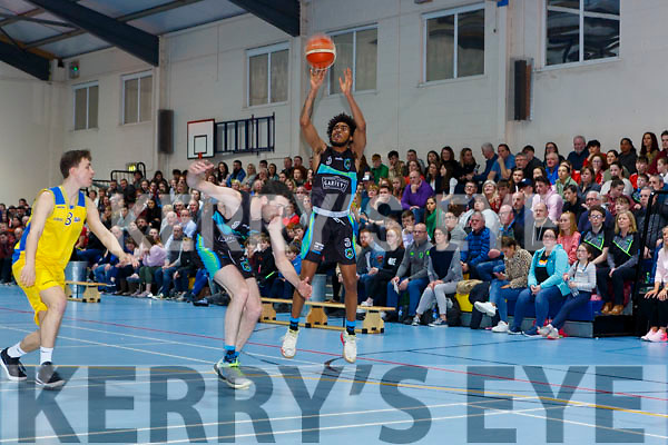 Jonathan Lawton Garveys Tralee warriors gets his shot over team mate Eoin Quigley and Conor Gilligan DCU in front of a packed stand during their clash in Castleisland on Saturday night