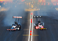 Feb 25, 2018; Chandler, AZ, USA; NHRA top fuel driver Billy Torrence (left) races alongside Doug Kalitta during a pedalfest in the first round of the Arizona Nationals at Wild Horse Pass Motorsports Park. Mandatory Credit: Mark J. Rebilas-USA TODAY Sports