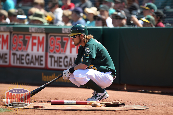 OAKLAND, CA - AUGUST 1:  Josh Reddick #16 of the Oakland Athletics waits in the on deck circle against the Tampa Bay Rays during the game at O.co Coliseum on Wednesday, August 1, 2012 in Oakland, California. Photo by Brad Mangin