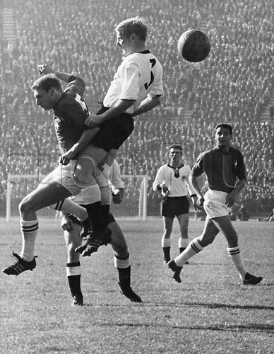 German defender Karl-Heinz Schnellinger (centre) jumps for a header against Swiss forward Antenen (left) during the 1962 World Cup preliminary round game. Germany against Switzerland in Santiago de Chile, Chile, on 6 June 1962. Germany won the  game 2-0 against Switzerland.