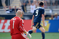New England Revolution goalkeeper Matt Reis (1) watches as Sebastien Le Toux (9) of the Philadelphia Union celebrates his goal. The Philadelphia Union and the New England Revolution  played to a 1-1 tie during a Major League Soccer (MLS) match at PPL Park in Chester, PA, on July 31, 2010.