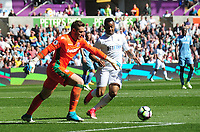 Stoke City's Jack Butland under pressure from Swansea City's Jordan Ayew<br /> <br /> Photographer Kevin Barnes/CameraSport<br /> <br /> The Premier League - Swansea City v Stoke City - Saturday 22nd April 2017 - Liberty Stadium - Swansea<br /> <br /> World Copyright &copy; 2017 CameraSport. All rights reserved. 43 Linden Ave. Countesthorpe. Leicester. England. LE8 5PG - Tel: +44 (0) 116 277 4147 - admin@camerasport.com - www.camerasport.com