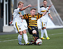Alloa's Michael Doyle challenges Dumbarton's Scott Agnew.