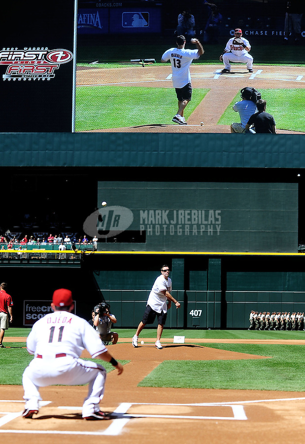 Apr. 5, 2010; Phoenix, AZ, USA; Arizona Cardinals former quarterback Kurt Warner throws out the first pitch prior to the game between the Arizona Diamondbacks against the San Diego Padres during opening day at Chase Field. Mandatory Credit: Mark J. Rebilas-