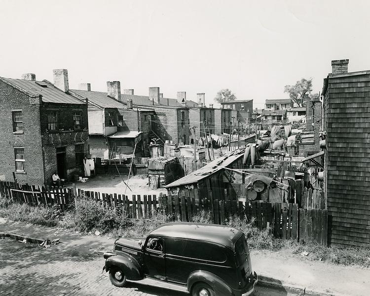 1950 September 19..Historical..St Pauls between Olnet & Lewis.Backyards Young Park..PHOTO CRAFTSMEN INC..NEG# 8-962.NRHA# 56..