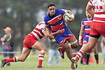 Sione Tuipulotu is tackled by Andrew West. Counties Manukau Premier Club Rugby game between Karaka and Ardmore Marist, played at the Karaka Sports Park on Saturday April 21st 2008. Ardmore Marist won the game 29 - 7 after being 7 all at halftime.<br /> Karaka 7 -Kalione Hala try, Juan Benadie conversion.<br /> Ardmore Marist South Auckland Motors (Counties Power Cup Holders) 29 - Sione Tuipulotu, Bryan Mulitalo, Damon Leasuasu, Joseph Ikenasio tries, Latiume Fosita 3 conversions, Latiume Fosita penalties.<br /> Photo by Richard Spranger
