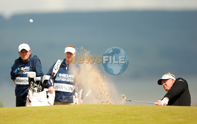 Colin Montgomerie blasts from a bunker on the third hole during the first days play of the Barclays Scottish Open, played over the links at Castle Stuart, Inverness, Scotland from 7th to 10th July 2011:  Picture Stuart Adams /www.golffile.ie  7th July July 2011
