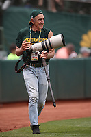 OAKLAND, CA - JUNE 9:  Oakland Athletics team photographer Michael Zagaris works during the game against the Kansas City Royals at the Oakland Coliseum on Saturday, June 9, 2018 in Oakland, California. (Photo by Brad Mangin)