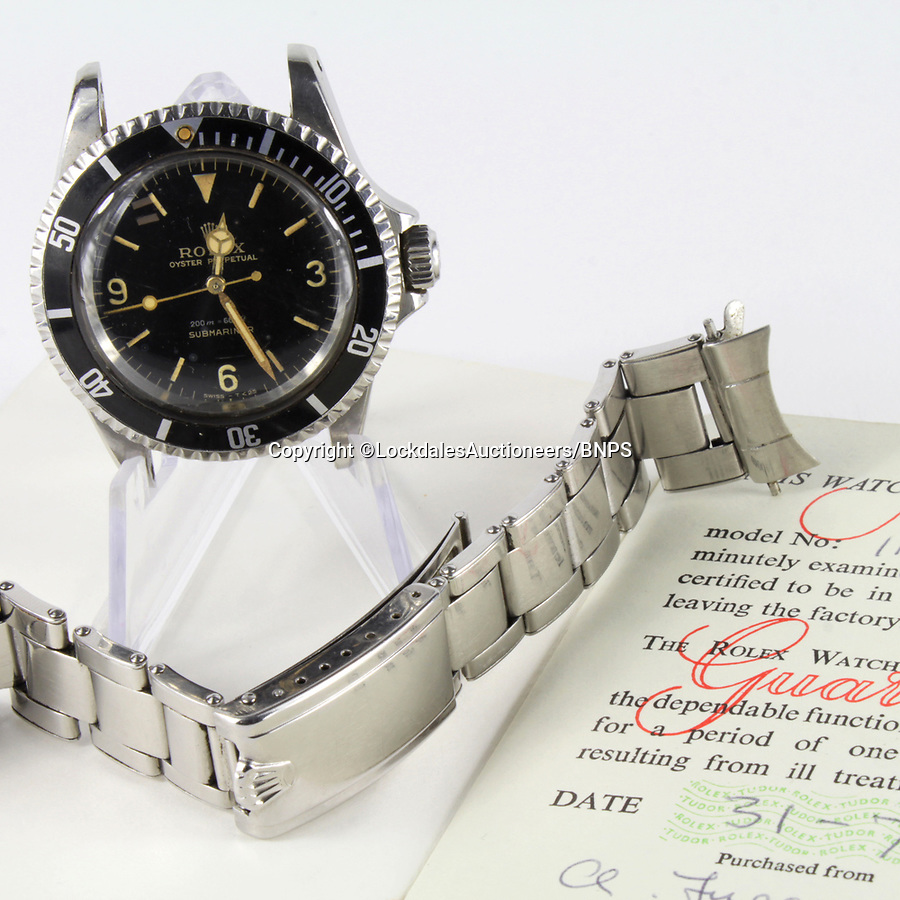 BNPS.co.uk (01202 558833)<br /> Pic: LockdalesAuctioneers/BNPS<br /> <br /> 60 year old watch auction leaves a family shaken and stirred...<br /> <br /> A James Bond-style Rolex watch that has been in the same family for nearly 60 years has sold for a whopping £182,400 - Over £100,000 over its estimate.<br /> <br /> The vintage Rolex Oyster Perpetual Submariner timepiece is almost identical to the one worn by Roger Moore's Bond in Live and Let Die.<br /> <br /> He also donned a similar wristwatch in The Man with the Golden Gun, while George Lazemby wore one in On Her Majesty's Secret Service.<br /> <br /> This one dates back to 1964 and had been in the same family in East Anglia since new.<br /> <br /> It sparked a bidding war when it went under the hammer with Lockdales Auctioneers, of Martlesham Heath, Suffolk.