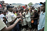 Police officers control the crowd in the Santa Teresa camp in Petionville, Haiti, during a distribution of food and other emergency supplies on February 1. Hundreds of families left homeless by the devastating January 12 earthquake live here. The ACT Alliance sponsored this distribution of food, buckets, and hygiene kits.