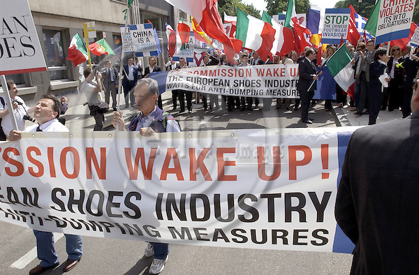 Brussels-Belgium - 15 June 2005---Representatives, producers, workers from the European footwear industry demonstrate against the massive imports from China and urge the European Commission to support Europe's own industry; at Rond Point Schuman, in front of the HQ of the EC and the seat of the EU-Council---Photo: Horst Wagner/eup-images