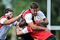 Matt Banahan of Bath Rugby is tackled. Bath Rugby training session on September 4, 2015 at Farleigh House in Bath, England. Photo by: Patrick Khachfe / Onside Images