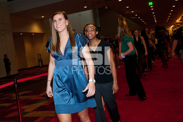 INDIANAPOLIS, IN - APRIL 1, 2011: Jeanette Pohlen and Melanie Murphy walk the red carpet at the Indianapolis Convention Center at Tourney Town during the NCAA Final Four in Indianapolis, IN on April 1, 2011.