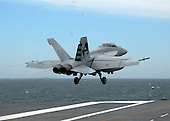 Atlantic Ocean - May 19, 2009 -- An F/A-18C Hornet assigned to Air Test and Evaluation Squadron (VX) 23, piloted by Lt. Patrick McKenna and Cmdr. Beau Duarte, on Tuesday, May 19, 2009 became the first aircraft to be catapulted from the aircraft carrier USS George H.W. Bush (CVN 77). George H.W. Bush is the tenth and final Nimitz-class aircraft carrier and is underway off the coast of Virginia conducting flight deck certification. .Credit: Michael Tackitt - U.S. Navy via CNP