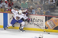 Jun 7, 2007; Hamilton, ON, CAN; Hamilton Bulldogs center (26) Maxim Lapierre checks Hershey Bears center (23) Andrew Joudrey into the boards during the first period in game five of the Calder Cup finals at Copps Coliseum in Hamilton, ON. The Bulldogs defeated the Bears 2-1 to win the Calder Cup. Mandatory Credit: Ron Scheffler