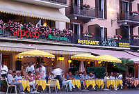 café, Switzerland, Ticino, Ascona, Lake Maggiore, Outdoor cafés along the lakefront in the city of Ascona at night.