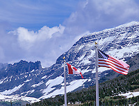 U.S. and Canada flags at visitors center at Logan Pass. Glacier National Park, Montana.