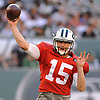 Josh McCown #15 of the New York Jets throws a pass during the team's annual Green & White practice and scrimmage at MetLife Stadium in East Rutherford, NJ on Saturday, Aug. 5, 2017.