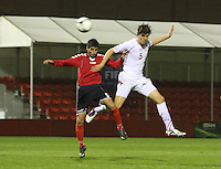 Hakob Loretsyan (left) and Ferid Matri compete in the air in the Armenia v Switzerland UEFA European Under-19 Championship Qualifying Round match at New Douglas Park, Hamilton on 11.10.12.
