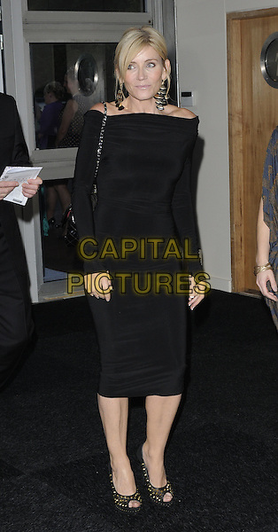 MICHELLE COLLINS.Prima High Street Fashion Awards, Battersea Evolutions, Battersea Park, London, England..September 8th, 2011.full length black dress off the shoulder long sleeves gold studs shoes peep toe gloves fingerless thumbs.CAP/CAN.©Can Nguyen/Capital Pictures.