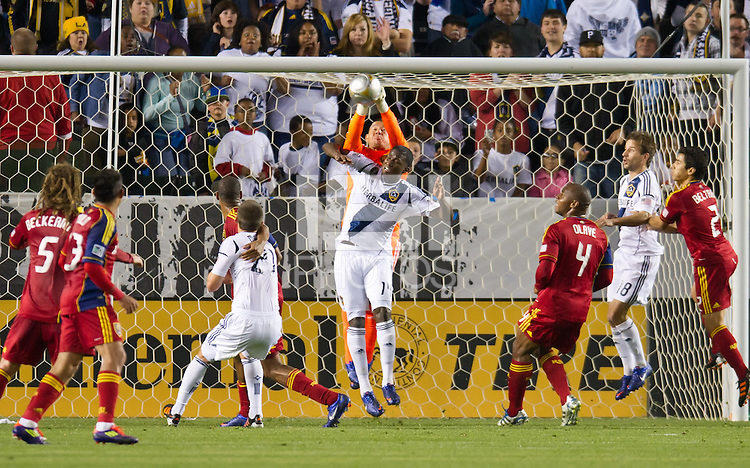 CARSON, CA - March 10,2012: Real Salt Lake goalie Nick Rimando (18) and LA Galaxy forward Edson Buddle (14) during the LA Galaxy vs Real Salt Lake match at the Home Depot Center in Carson, California. Final score LA Galaxy 1, Real Salt Lake 3.