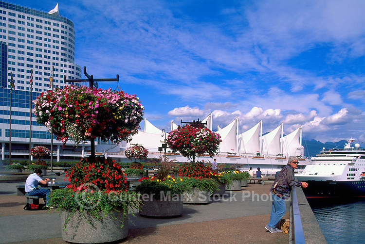 "Vancouver, BC, British Columbia, Canada - Hanging Flower Baskets at ""Granville Square"", overlooking ""Canada Place"" Trade and Convention Centre and Cruise Ship Terminal, Spring / Summer"
