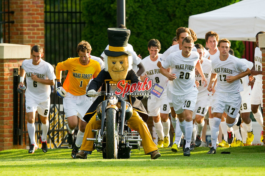 The Wake Forest Demon Deacons mascot leads the men's soccer team onto the field prior to the match against the Wofford Terriers at Spry Soccer Stadium on August 25, 2012 in Winston-Salem, North Carolina.  The Demon Deacons defeated the Terriers 1-0.  (Brian Westerholt/Sports On Film)